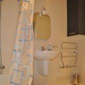 Second bathroom with bathtub and shower curtain