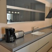 Modern kitchen with ample workspace and breakfast bar